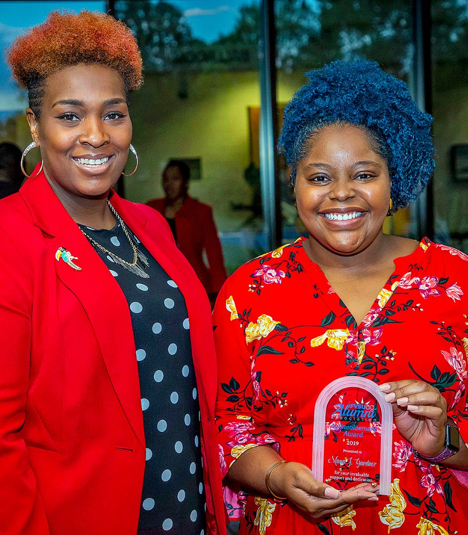 Fanisha Maze (left), president of the FVSU Agricultural Alumni Association, presents Maya Gardner (right), senior agricultural economics major, with the Ag Involvement Award.
