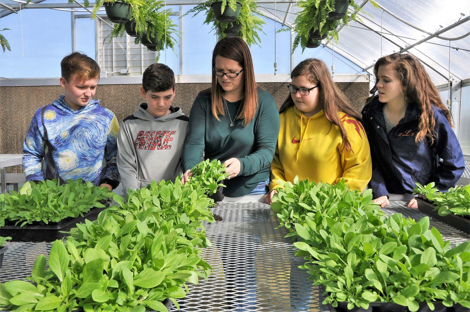 Serving also as a Future Farmers of America (FFA) advisor, Christina Sanders provides hands-on training for her students in the on-campus greenhouse.