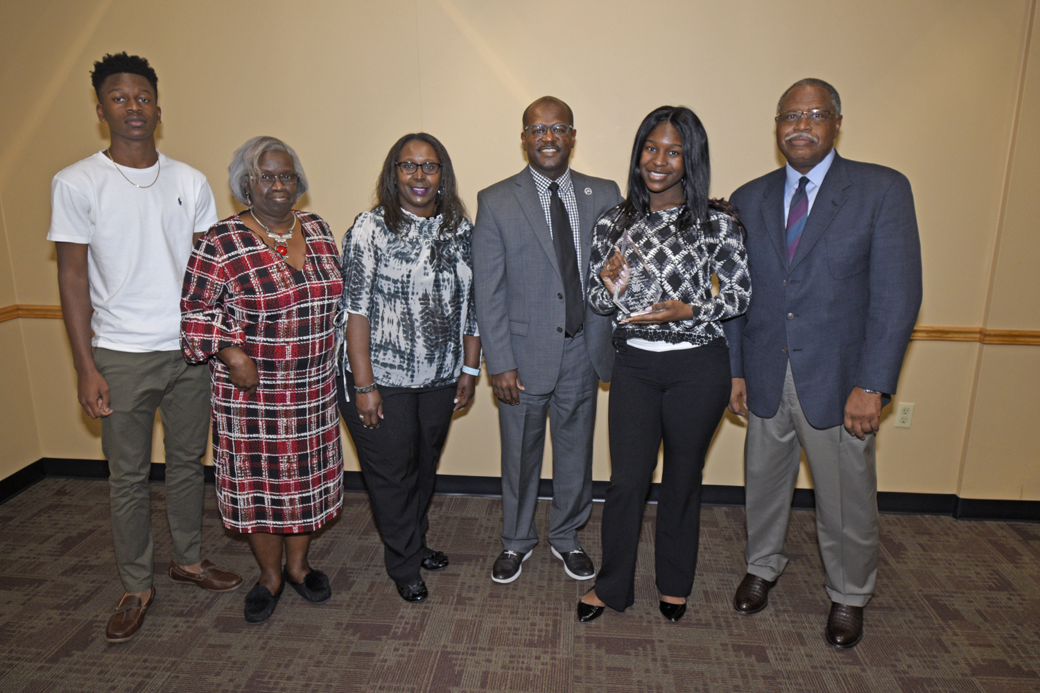 Phillip Petway (fourth from left) and Dr. Mark Latimore Jr. (far right), FVSU Extension administrator, presents Terrica Bond (second from right) and her family with the 4-H Family of the Year Award.
