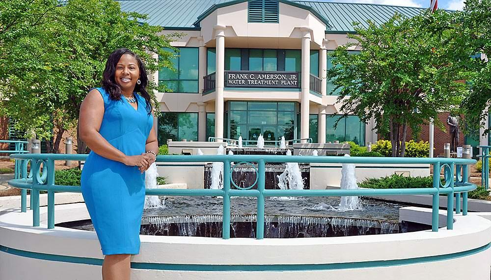 Lisa Golphin stands in front of the Frank C. Amerson, Jr. water treatment plant in Macon, GA.