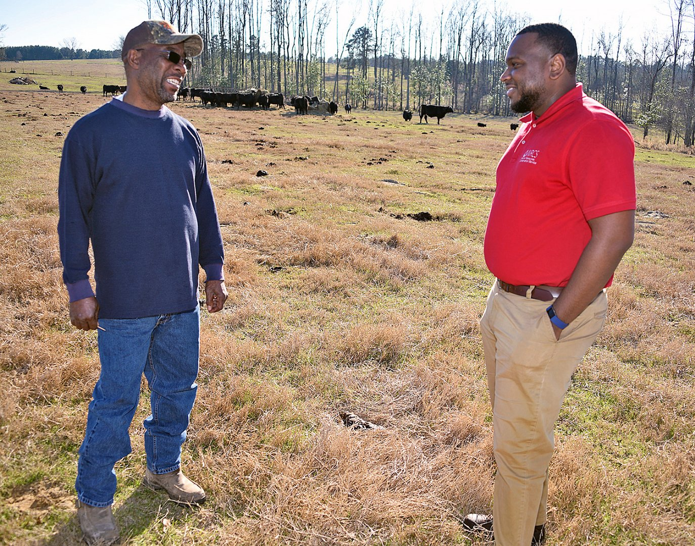 Jazmond Carter shares a moment with a client during a field visit.