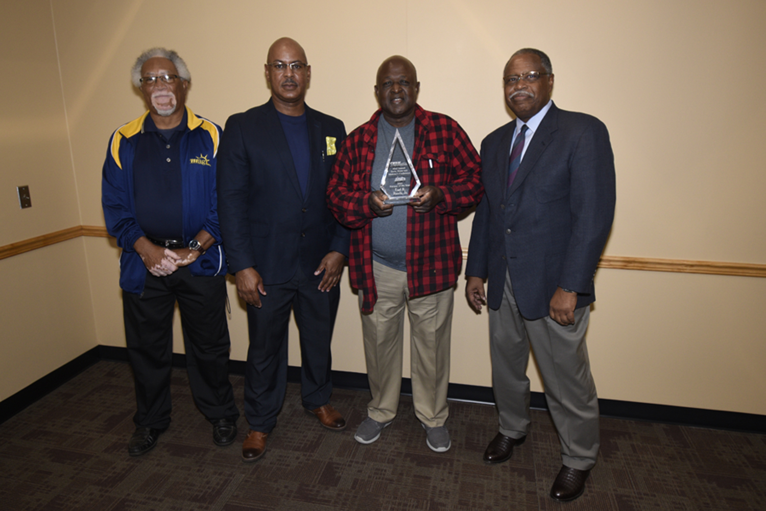 Earl Rawls (holding award) receives the 2019 ANR Farm Family of the Year Award from FVSU Extension personnel (from left) Leon Porter, program assistant for Houston County; Charlie Grace, FVSU Extension agent for Dougherty, Lee and Worthy Counties (far rig