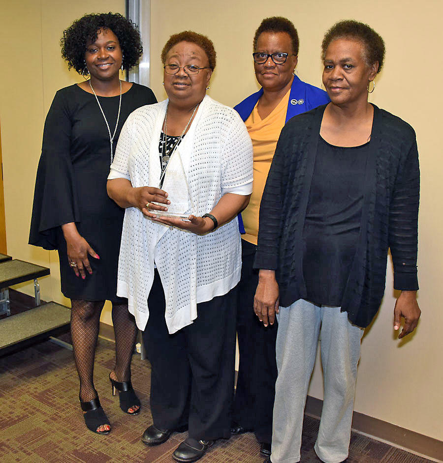 Brenda Maddox (left), Fort Valley State University's Marion County extension agent, poses with 2017 Family and Consumer Sciences Family of the Year awardee Mary King (center) and members of the King-Taylor family at FVSU's Pettigrew Center Feb. 21.