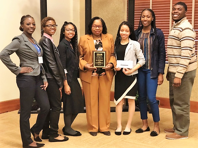 FVSU professor Dr. Linda Johnson (center) joins her Family and Consumer Sciences Club officers after receiving the Julius Benton Professional Improvement Award at the University of Georgia (UGA) Griffin campus.