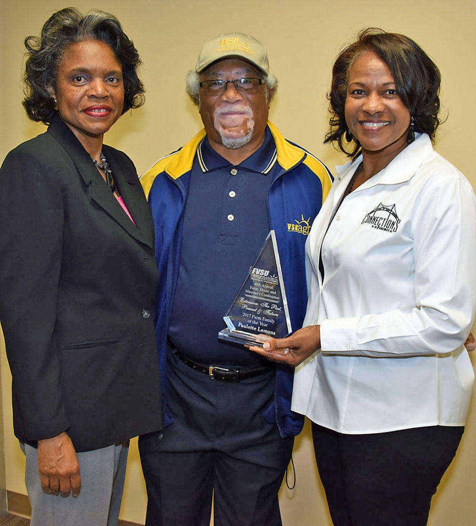 Leon Porter (center) FVSU's Houston County program assistant, poses with 2017 Agriculture and Natural Resources Farm Family of the Year Awardees Marsha Moore (left) and Paulette Lemons of Connections on the Parkway at FVSU's Pettigrew Center Feb. 21.