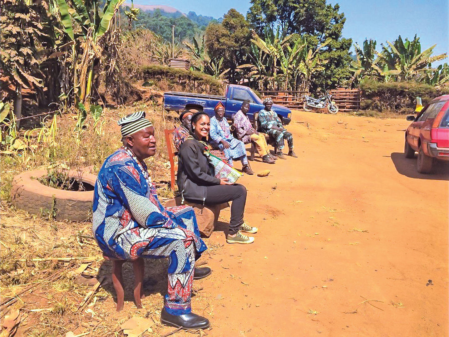 Ghangela Jones sits with local people during her time in Cameroon.